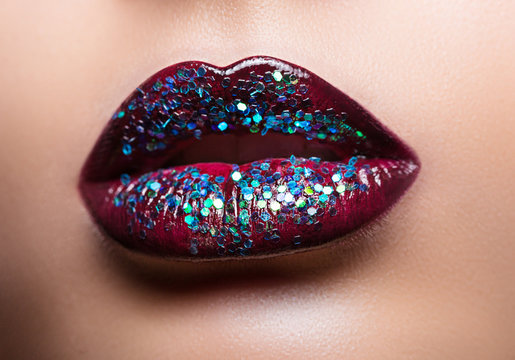 Beautiful female lips with magnificent make-up close-up.