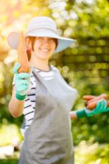 Brunette in hat holding carrot