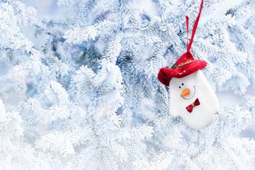 Christmas Snowman Sock Hanging on a Snow Tree Branch