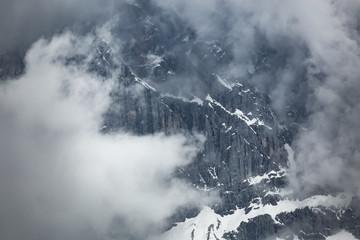 Cloudy snowy mountains peaks landscape. Dolomites Alps