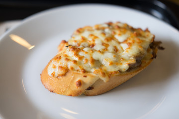 Bruschetta with baked mushrooms and  cheese