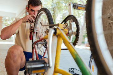 Man checking his Bike Wheel after being repaired