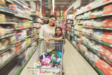 Glad members of family in supermarket