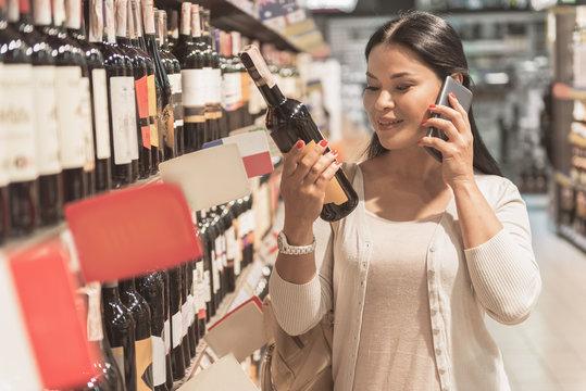 Cheerful female person choosing beverage