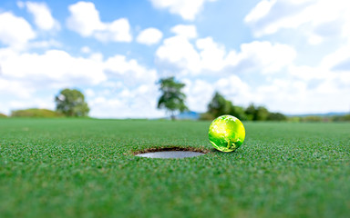 Green earth golf on a green put blue sky background. World golf. The Planet Earth original image from NASA