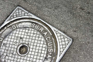 Manhole cover in Syracuse, Italy