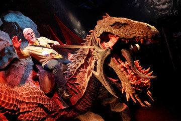 A man rides a model of a dragon during the opening of the world's largest computer games fair Gamescom in Cologne