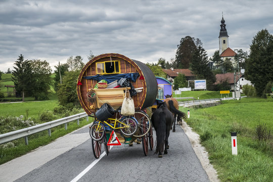 Horse drawn wagon on the road in central Slovenia