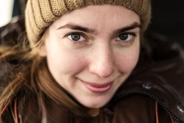 Selfie of happy woman in a woolen hat
