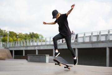 Skater jumping in skate park