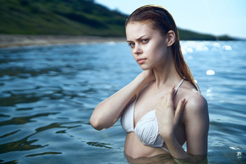 Beautiful young woman is resting on the sea, ocean, beach,let, sun