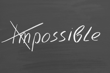 Impossible possible. Text on chalkboard