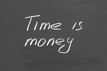 Time is money. Text on chalkboard