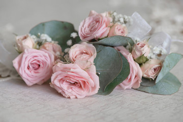 Bohemian wedding bouquet featuring dusky pink large roses and over-sized leaves