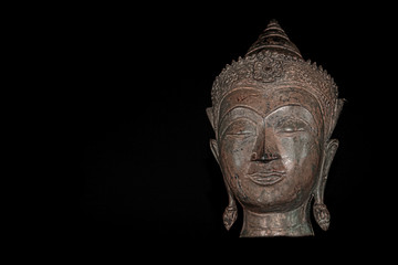 Contemporary Buddhism. The future of religion. High contrast image of metallic buddha head.
