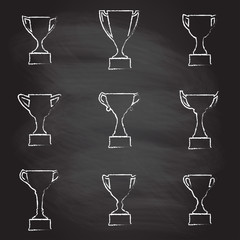 Trophy Cup icon set isolated on blackboard texture with chalk rubbed background. Vector illustration.