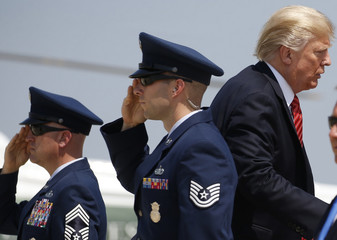 U.S. President Trump  is saluted as he boards Air Force One before departing for Arizona from Joint Base Andrews, Maryland