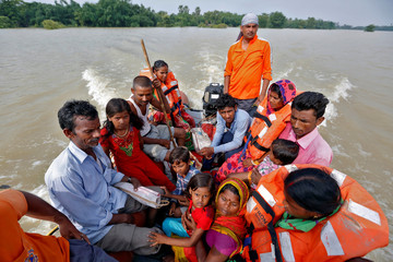 People are rescued from a flooded village in the eastern state of Bihar