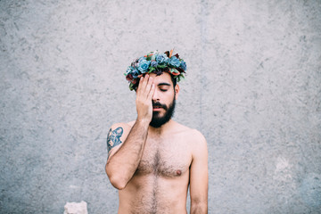 handsome man with a flower cron