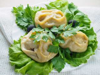Beef manta dumplings with meat on the plate