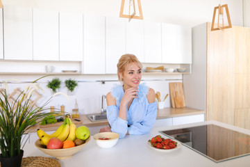 Stylish girl cooks posing for breakfast in morning, standing at