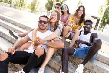Group of young hipster friends looking at camera in an urban area.