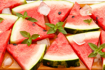 Slices of fresh watermelon with ice and mint. Selective focus