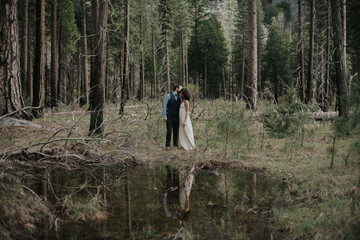 Elopement couple in forest on wedding day