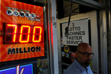 A screen displays the value of the Powerball jackpot at a store in New York City,