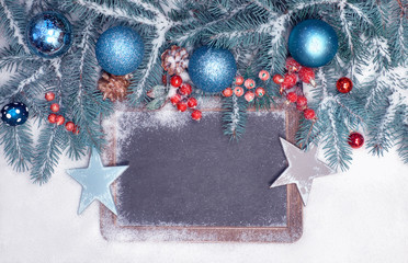 Empty blackboard with Christmas decorations on snow, space