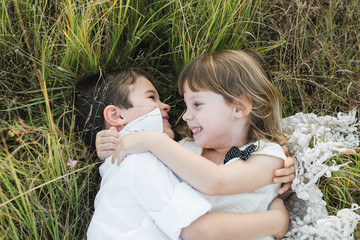 Two Children Lay In The Grass