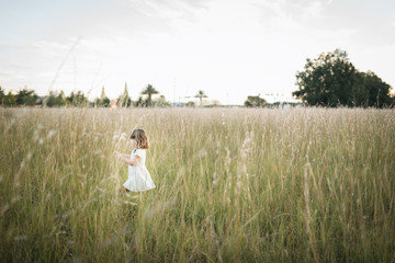 Young Girl Playing In A Open Field