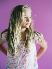 blonde girl in floral shirt against purple background