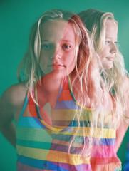 double exposure of blonde girl in rainbow shirt