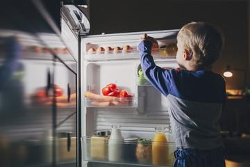A Boy Taking Food From Fridge
