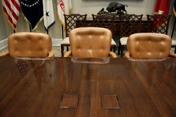 The Presidential chair (higher than others) is seen in the Roosevelt Room