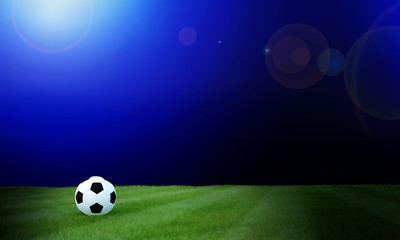 Football black and white color on grass soccer field with blurred blue gradient background.3D Rendering