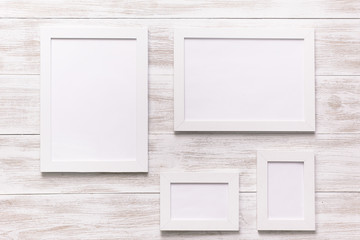 wooden white background with photo frame. Blank picture frame template