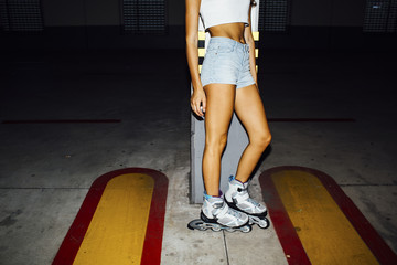 Standing woman with rollerblades