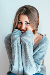 Portrait of a pretty woman with a sweater