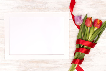 Post blog social media 8 march. View from above with copy space. Banner template layout mockup for woman day. White wooden table with tulips. festive bouquet for greeting card with place for text