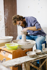 Man does pottery