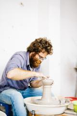 Handcrafter makes pot