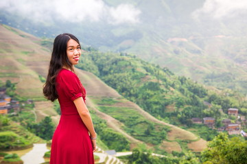 Asian girl at rice terrace viewpoint wearing