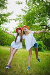 Beautiful Teenage Girls Having Fun in Park Outdoor