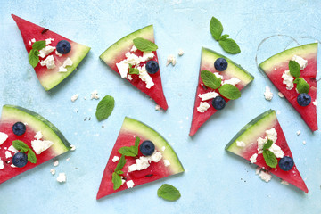 Watermelon slices with feta and mint - summer appetizer.Top view with copy space.