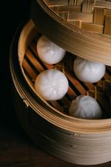 Homemade dumplings in a bamboo steamer