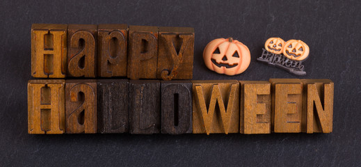 Happy Halloween Sign on a Black Background