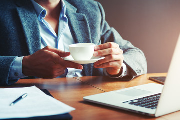 businessman drinking morning coffee at office