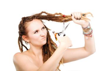 girl cutting her dreadlocks